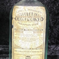 Lydia E. Pinkham's Vegetable Compound bottle with label